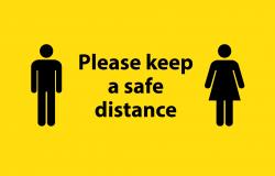 Please keep a safe distance sign